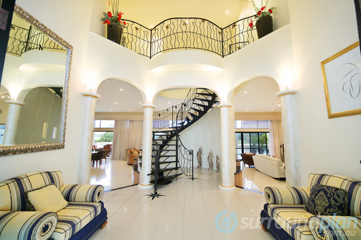 entry opens to feature spiral staircase