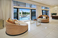 Thumbnail: living room opens out to the pool area