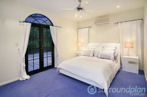 bedroom opening to private verandah